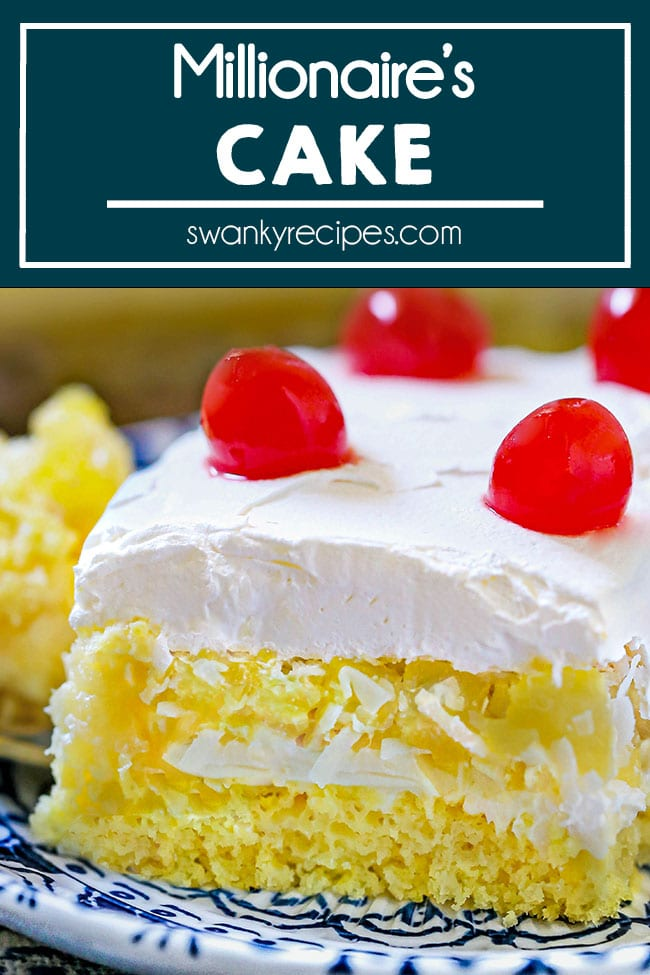 Tropical Millionaire's Cake - A square slice of millionaire's cake served on a white and blue plate. A yellow cake with creamy pineapple cream cheese pudding, coconut center with pineapple, whipped cream frosting and cherries on top.