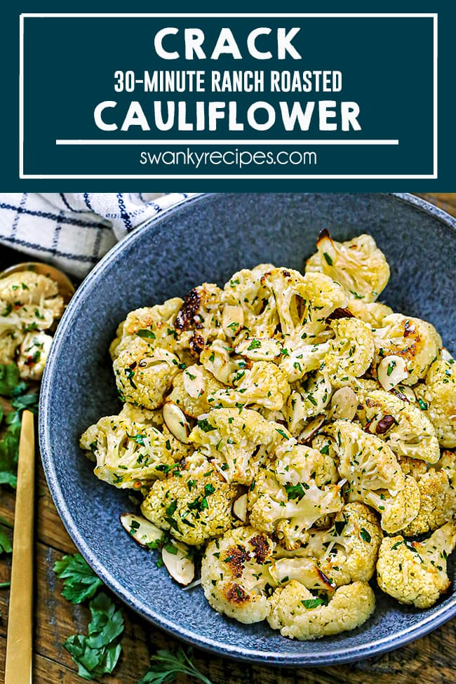 Best Roasted Cauliflower - Cauliflower florets served in a dark blue pottery bowl on a wooden platter. Garnished with freshly chopped parsley and almonds.