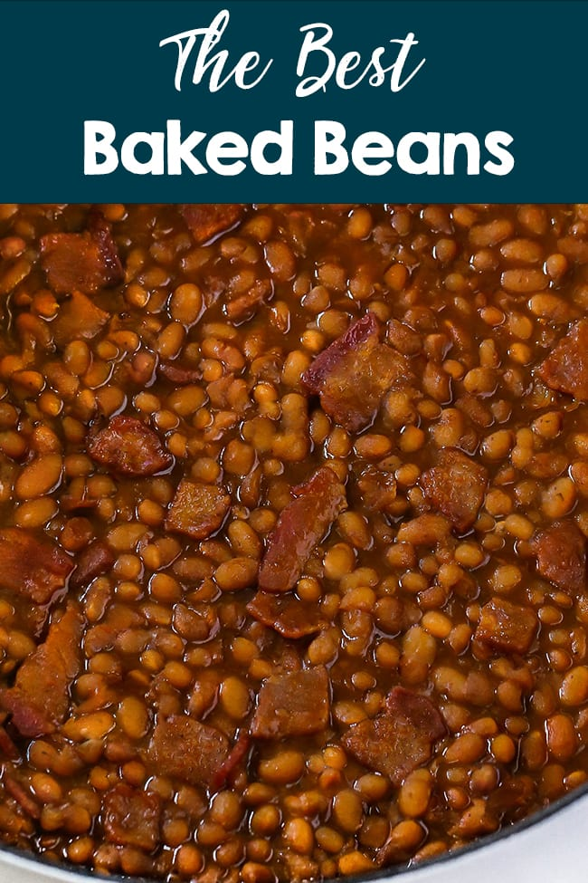 Best Baked Beans - A closeup of baked beans in a thick brown sauce with pieces of bacon.