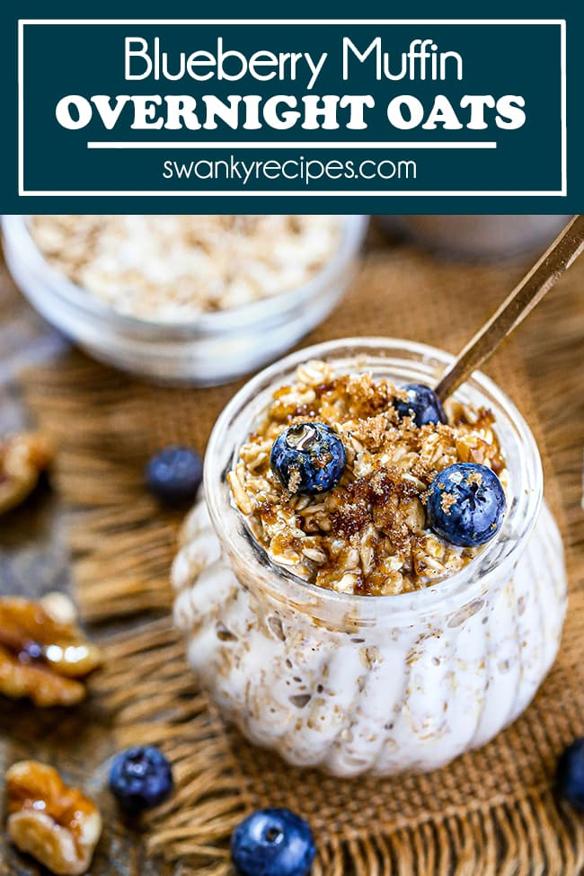 Blueberry Overnight Oats - A jar of oats soaked in milk and served with blueberries, nuts, and syrup on burlap and a wooden board.